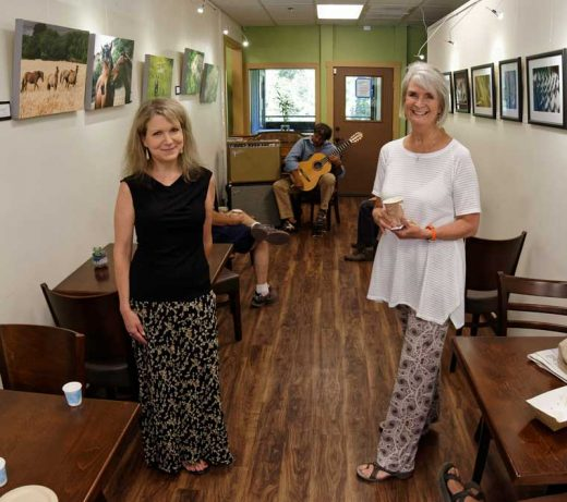 Local fine art photographers Caryn Gilbert (left) and Erin O'Neill opened their photography exhibit at Sky Island Gallery on Saturday, July 2. O'Neill is displaying canvas wildlife prints and Gilbert is featuring abstract prints. Photo by Tom Kluzak