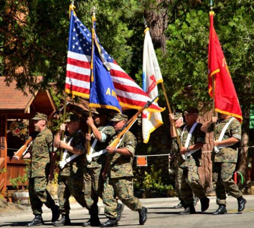 American Legion Post 800's color guard leads the Fourth of July parade down North Circle Drive.Photo by Tom Pierce