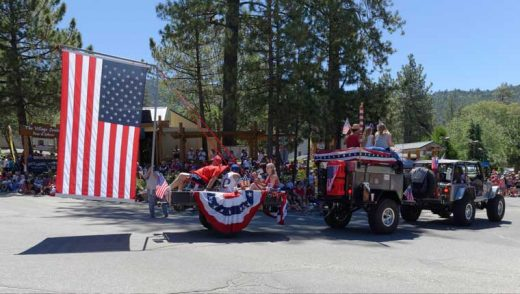 The Hemet Jeep Club is strong enough to haul two units and a large American flag. Photo by Tom Kluzak