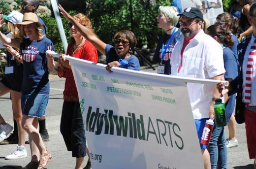 Pam Jordan, (center) president of the Idyllwild Arts Foundation, leads the Idyllwild Arts parade contingent.Photo by JP Crumrine