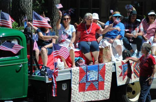 The Mountain Quilters' float was covered in red, white and blue.Photo by JP Crumrine