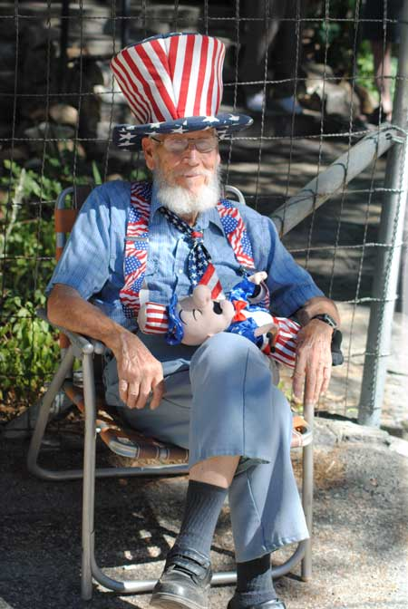 Lloyd Wood, former Idyllwild postmaster, enjoyed the Fourth of July Parade from his chair. Photo by JP Crumrine