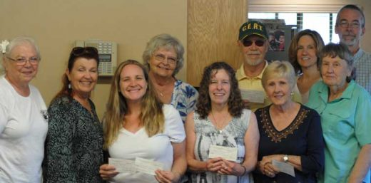 Recipients of the Pine Cove Property Owners Association's annual community gifts and donations are pictured here (from left) Marlene Pierce, PCPOA president; Callie Wight, Idyllwild HELP Center; Colleen Meyer, Idyllwild HELP Center; Karen Doshier, Idyllwild Soroptimists; Jayne Davis, Idyllwild Scholarship Fund; Mike Feyder, Mountain Disaster Preparedness; Carolyn Levitski, Idyllwild Area Historical Society; Janice Murasko, Animal Rescue Friends of Idyllwild; Barbara Jones, PCPOA; and Bill Tell, Mile High Radio Club.   Photo by JP Crumrine