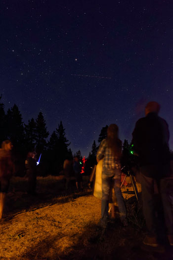 Laser pointers and red lights leave traces on the ground and in the sky as Amanda Allen, park interpreter at the Idyllwild Nature Center, and Ryan Strickland, Nature Center volunteer and teacher at Idyllwild Arts Academy, explain the mysteries of the skies at the special stargazing program held at Idyllwild County Park Campground on Friday evening.  Photos by Tom Kluzak
