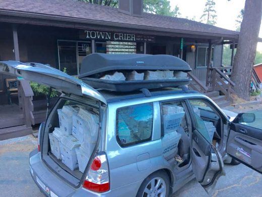 With a great deal of calculating, Co-publisher Jack Clark managed to pack 3,350 Fourth of July Town Criers filled with Lemon Lily Festival programs inserts and 2,000 extra programs into a 2006 Subaru Forester that proceeded to climb 4,200 feet in elevation from Banning to Idyllwild-Pine Cove Wednesday morning, June 29. (With the help of a Thule on top, of course.)Photo by Jack Clark