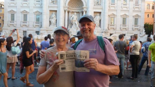 Martin and Janet Jones of Idyllwild traveling with our Town Crier in front of the Trevi Fountain in the Piazza de Trevi in Rome.  Photo courtesy the Joneses