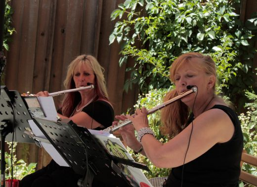 Christine Ziegenfuss-Holanda and fellow flutist Kathy Harmon-Luber playing together as Winds of Change for Tommy's Kitchen on Saturday.Photo by John Drake