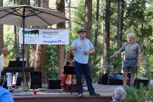Famous Idyllwild actor Conor O'Farrell served as emcee at Wine in the Pines on Saturday, July 9, a fundraiser for the Idyllwild Community Fund held on the grounds of the Rainbow Inn. O'Farrell is preparing to attract more bids for his offer of a chance to have dinner with him and his wife, Holly. (He removed his shirt.) ICF raised several thousand dollars, including $500 for the opportunity to dine and to converse with the O'Farrells. Photo by Tom Kluzak