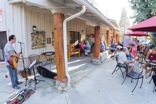 Members of the Art Alliance of Idyllwild filled the patio around the Higher Grounds Gallery at the Members Mingle on Tuesday, July 26. David The Page supplied the entertainment as the gallery introduced a new show. Gift certificates to Jack Farley's, donated by Rob Padilla, were awarded to two attendees and there was a silent auction for books donated by Friends of the Idyllwild Library.Photo by Tom Kluzak