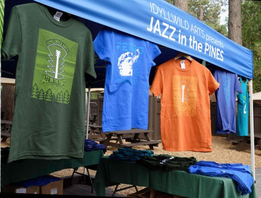 The official 2016 Jazz in the Pines T-shirts were introduced on Tuesday, Aug. 2, at Ferro. Patrons tickets also were available. T-shirts come in men's and women's sizes; women also have the option of a tank top. Proceeds go to support Idyllwild Arts. Jazz in the Pines starts Friday evening, Aug. 19, with the Patrons Dinner and runs through Sunday, Aug. 21. Photo by Tom Kluzak
