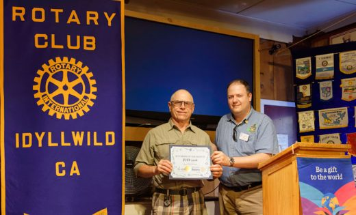 Idyllwild Rotary Club President Marc Kassouf (right) presents the Rotarian of the Month award to Chuck Weisbart, who is the Rotary's immediate past president. Not only has Weisbart served in an exemplary fashion but also, along with his wife Susan, guided the club through the logistical nightmare of the yearly 4th of July Parade. Photo by Tom Kluzak