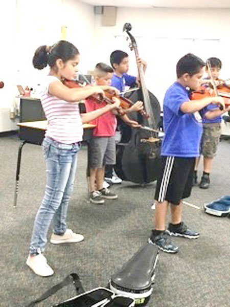 Musica! students,parents,mentors and teachers met on Saturday, Aug. 27 for their Swing into Strings bootcamp before the first day of class on Sept. 6.  Photo courtesy anna Ancheta