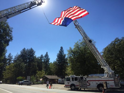 "Idyllwild Fire and the Idyllwild Volunteer Fire Company set up their annual 9/11 tribute on Highway 243 Sunday afternoon. Idyllwild Fire Chief Patrick Reitz wrote, ""As 9/11 falls on a Sunday we are encouraging everyone to spend this day with their families. IFPD will again show our respect to those whom made the ultimate sacrifice by flying Old Glory high and proud from our Ladder on T621. Please take a moment to say I love you to your loved ones & remember the families of all of those that died in and since as a result the terrorist attacks of September 11, 2001."" Photo by Jenny Kirchner"