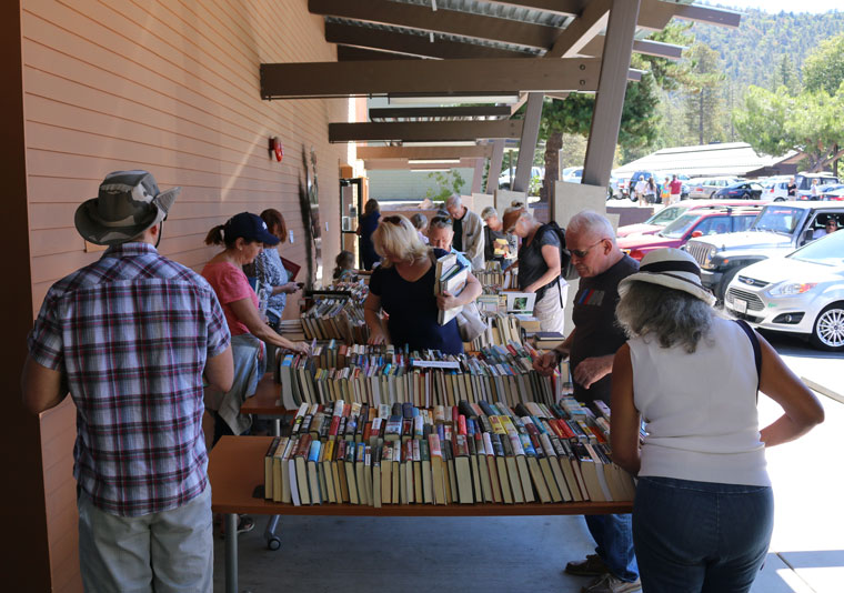 A large crowd came to the Friends of the Idyllwild Library's annual Labor Day book sale last Saturday. Books for a quarter and free VHS tapes were a big attraction. Photo by Alan Belanger