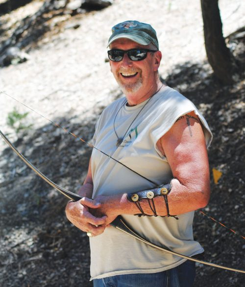 Robert Hewitt, archer and community volunteer, keeps his arm steady and his aim true.Photo by Marshall Smith