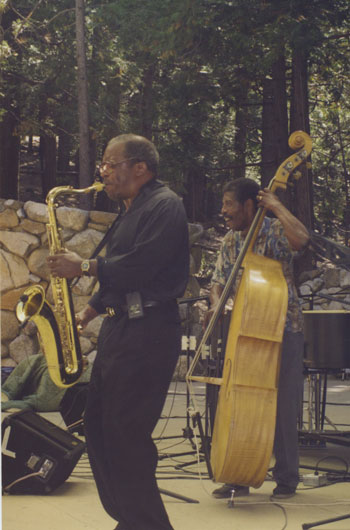 Marshall Hawkins (right) on bass and Herman Riley (front left) on sax are seen here on the main stage of Holmes Amphitheatre in the early years of Jazz in the Pines, circa early 1990s.Photo courtesy Anne Erikson