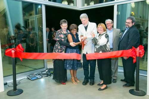 "Saturday evening was the official opening of the William M. Lowman Concert Hall on the Idyllwild Arts campus. Cutting the red ribbon are (from left) Faith Raiguel, past chair of the board of governors; Pamela Jordan, president and head of school; William Lowman, past headmaster; Carolyn Lowman; Dwight ""Buzz"" Holmes and Jeffrey Dvorak, chair of the board of governors.  Photo by Jenny Kirchner"