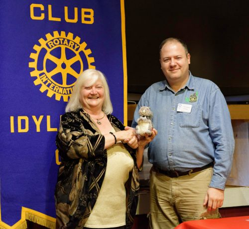 Reverend Shelly Downes, founder of the Spiritual Oneness Center, displays the Idyllwild Rotary squirrel she received from Rotary President Marc Kassouf at the weekly Idyllwild Rotary meeting on Wednesday, Sept. 14. Downes informed Rotary members about the history and programs offered at the non-denominational facility, located on Cedar Street.  Photo by Tom Kluzak