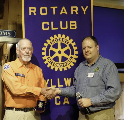 Glen Henderson (left) receives an Idyllwild Rotary mug from Rotary President Marc Kassouf at the weekly meeting on Sept. 21. Henderson, a member of Riverside Mountain Rescue Unit, spoke to the members and guests about the arduous but vital work the rescue does on behalf of residents of the Hill and surrounding environs.Photo by Tom Kluzak