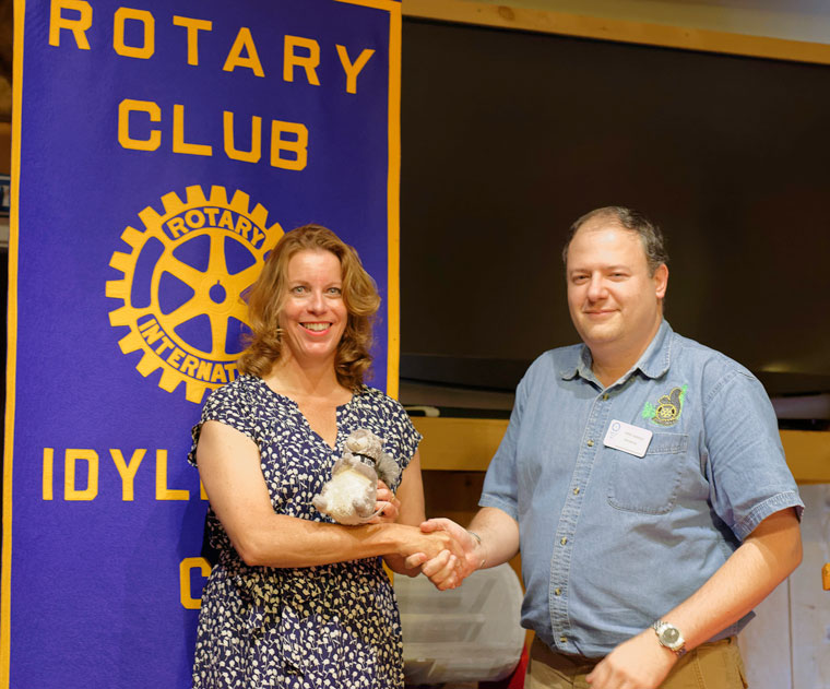 Christina Nordella receives an Idyllwild Rotary squirrel from Rotary President after she spoke to the club at its weekly meeting on Wednesday, Aug. 31. Nordella has been an active volunteer and philanthropist in Idyllwild for many years. Photo by Tom Kluzak