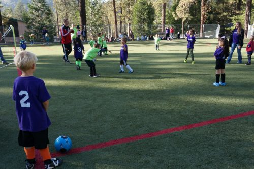 Idyllwild youth warm up before the weekly soccer match. Photo by Chandra Lynn