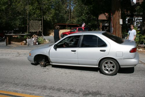 When things go wrong they really go wrong. Leo Blair, 19, and friend Todd Wood were taking Leo's grandmother's car to Idyllwild Garage for an alignment problem. They were on North Circle just up from the Rustic, when the lug nuts came off the front driver's side wheel. The wheel came off and kept rolling nearly to the intersection with Highway 243 when a passerby stopped it with his foot. Photo by Marshall Smith