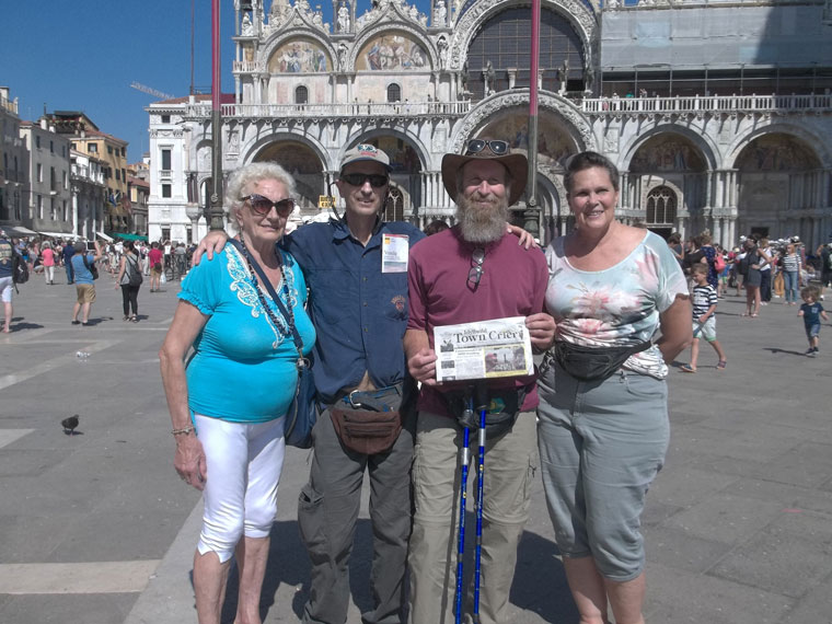 Travels with the TC Aunt Elita (whom they were visiting and who lives near Venice), brothers David and Steve Kunkle, friend Maria Byron, with the Town Crier while they were at St. Marks Square in Venice.Photo courtesy Steven Kunkle