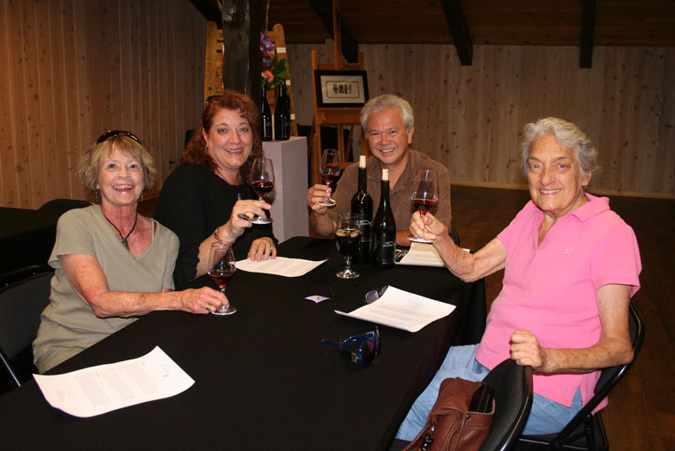 Chris Johnston, winemaker of Middle Ridge Winery, gives a wine tasting of his newest releases upstairs at the Tasting Gallery at a Saturday wine release event. From left, Terry Cooper of San Diego, Susan Freed of Idyllwild, Johnston, and Susan's mother, Marsha Freed, also of Idyllwild, enjoying a Grenache, a Pinot Noir and a 2014 Sangiovese. Photo by Becky Clark