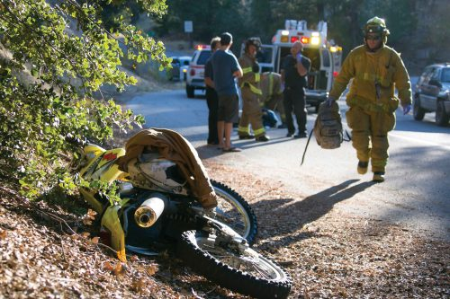 On Tuesday, Oct. 11, at about 5 p.m., Idyllwild Fire responded to a traffic collision on Highway 243 just south of mile marker 3, near Saunders Meadow Road. According to the California Highway Patrol's incident report, a yellow motorcycle ran into a silver Toyota Prius. The occupants of the Prius, (background, left) appeared to be uninjured as they spoke with Fire Capt. Jack Peckham and Battalion Chief Mark LaMont (background, center). IFPD treated the motorcyclist at the scene. The extent of his injuries were unknown but he was listed as having major injuries, according to CHP's incident summary. Photo by Jenny Kirchner