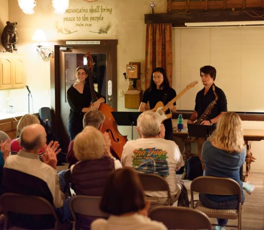 Bella Hartmann (left) was the first speaker in this year's Idyllwild Community Center Speaker Series at Silver Pines Lodge on Oct. 13. Bella is a senior at Idyllwild Arts, which has partnered with ICC to provide interesting and informative presentations. Bella described her experience in arts education. As an added bonus, she brought fellow students Sumi Onoe (center) and Arsel Kalemolu to play some outstanding jazz.  Photo by Tom Kluzak