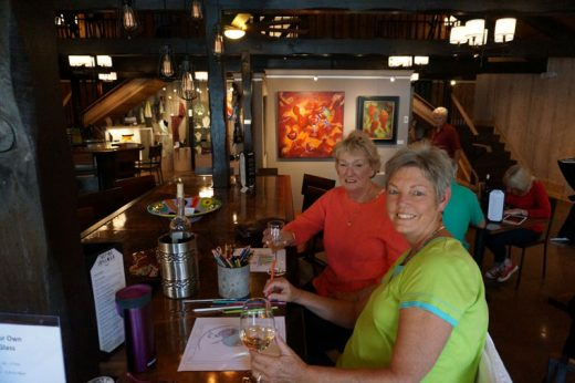 "Martha Lumia and friend Mizzi Diamond enjoy the ""Corks and Color"" exhibition Friday at Middle Ridge Winery and Tasting Gallery.Photo by Chandra Lynn"