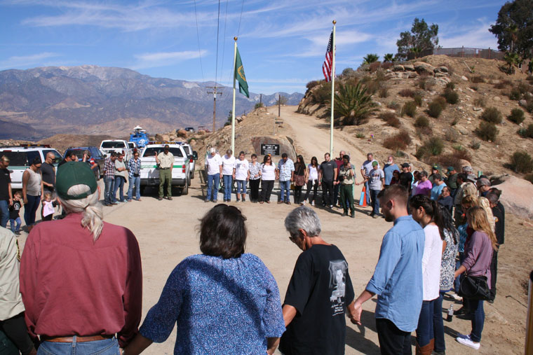 Families, friends and co-workers of the five U.S. Forest Service Engine 57 firefighters killed in October 2006 take a moment of silence near the site where the five died in the Esperanza Fire in Twin Pines. Photo by Becky Clark