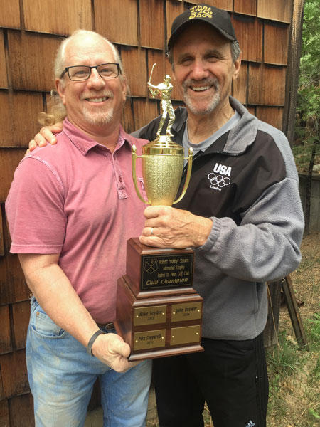 Idyllwild's Palms to Pines Golf Association's 2015-16 Club Champion Pete Holzman (left) accepts the Bob Stearns Memorial Club Champion trophy from the 2014-15 Club Champion Pete Capparelli. Photo by Dora Dillman