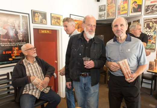 A private screening of an upcoming national infomercial featuring many local residents took place at the Rustic Theatre Saturday morning. The infommercial by locals Marcia Waldorf and Jim Crawford included Lou Bacher (standing, left) and Pete Capparelli (standing, right). Actor Conor O'Farrell (seated) was not included in the 30-minute show to air on TV in January. Popcorn and champagne were served. Photo by Peter Szabadi