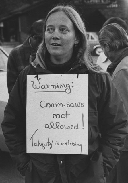 """After rallying at Eleanor Park (now Jo'An's) in November 1975, a group walked to Strawberry Creek to inspect doomed trees. Many carried """"Save Our Trees"""" placards. File photo"""