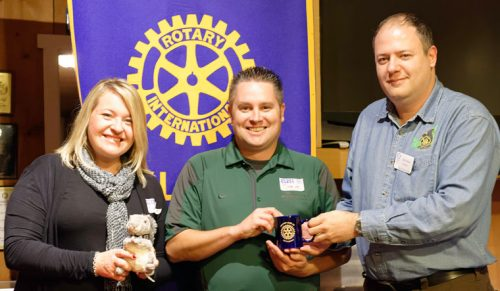 Joanna Glesmann-Dixon (left) and Steve Pettit (center) of Bankers Life and Casualty Co. in Palm Springs receive an Idyllwild Rotary squirrel and mug from Idyllwild Rotary President Marc Kassouf (right) as tokens of appreciation for addressing members at the weekly meeting on Oct. 5. Glesmann-Dixon and Pettit addressed the complicated issues of retirement planning, especially as it concerns health care, and offered to help navigate the Medicare and Social Security systems. Photo by Tom Kluzak