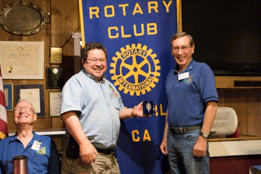 Idyllwild Rotary member John Graham (left) receives an official mug from President-elect Roland Gaebert at the weekly Rotary meeting on Oct. 12. Graham spoke to the club about his 38-year experience as a teacher of disabled high school students. Photo by Tom Kluzak