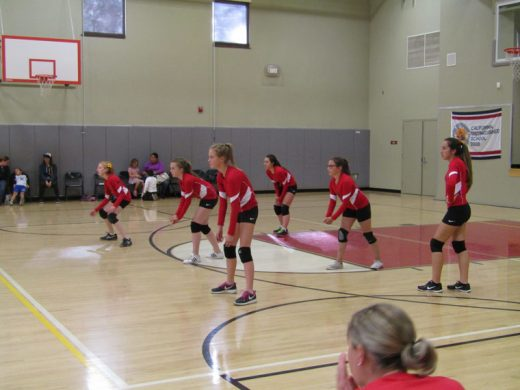Waiting to receive a serve from St. Hyacinth Academy of San Jacinto are members of the Idyllwild School team (front row, from left) Geneva Dagnall, Brooke Taylor and Emma Righetti, and in the back row (from left) are MacKenzie Nunez, Maraja Kelly and Payton Priefer.  Photo by Amy Righetti