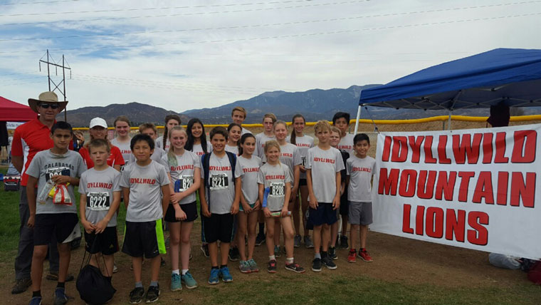 The Idyllwild Middle School Cross Country Team competed at the Beaumont Invitational at Noble Creek Park on Oct. 27. The kids have been training hard for the last couple of months and their efforts paid off in this event.  Front row, from left, Fernando Maldonado, Seth White, Eddie Rincan, Breanna Sheppard, Colby Sonnier, Hannah Johnson, Rylan Righetti, Jakob Parsons and Rene Montoya. Back row, from left, coaches Lee Arnson and Misty Hitchcock, Jenah Arnett, Austin Gooch, Chloe Lovett, Sivoney Garcia, Grace McKimson, Zach Gray, Tobey Posey, Matilda Terry, Lilah Whitney, Levi Davis and Arturo Rincan.Photo courtesy Lee Arnson