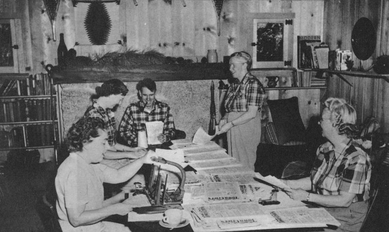 Much of the Town Crier's early success was due to the many hours of volunteer labor that went into its production. This photo, taken in the late 1940s, shows a living room assembly line with Marj Shideler (front left), Minnie Hodge (right) and Hazel Crees (standing). Ernie Maxwell is seated and at top left is Betty Maxwell.			 File photo