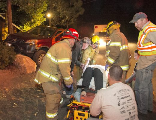 Cindi Hinds is put onto a gurney after being hit by a car Saturday evening. Idyllwild Fire transported her to the U.S. Forest Service's Keenwild Station helipad from where she was airlifted to Desert Regional Medical Center with major injuries. According to the California Highway Patrol, at about 5 p.m., Ed Hansen was driving his Honda CRV east on North Circle Drive and struck Hinds. Both Hinds and Hansen are Idyllwild residents. Hansen was treated at the scene. Photo by Jenny Kirchner