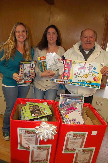 The Art Alliance of Idyllwild delivered new art supplies to the HELP Center for its Holiday Drive. HELP Center representatives Colleen Meyer and Skye Zanbrana, are shown here with Zack Steinhaus, AAI board member. Photo by Shana Robb