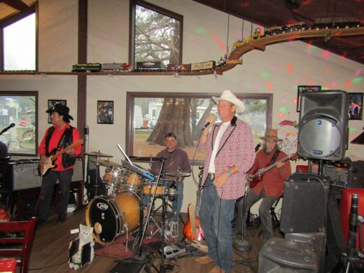 Mark Huston and the Working Men performed at Jo'An's Saturday afternoon before the annual Tree Lighting Ceremony. Photo by Amy Righetti