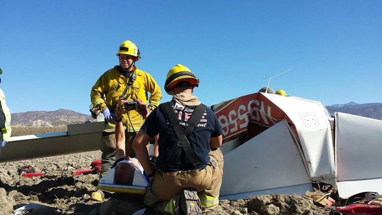 Dave Pelham and Dave Womack survived a crash landing of Pelham's plane on Thursday, Nov. 10. In this photo, Pelham already strapped to a backboard by emergency responders, holds up his camera, turns on the video function and scans his plane from front to rear to document the damage.Photo by Dave Womack