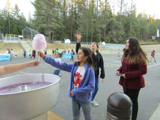 Anna Lucia LoPresto enjoys some cotton candy at Idyllwild School's first Fall Festival last Friday. Photo by Amy Righetti