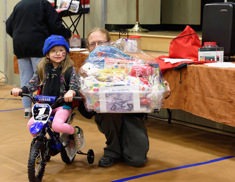 Idyllwild School gym was filled with shoppers perusing the wares of 35 vendors and hoping to win one of the fabulous gift baskets at the 50th-annual Rotary Harvest Festival on Friday and Saturday, Nov. 25 and 26. Proceeds are used to support the Idyllwild community throughout the year, including scholarships and incentives for Idyllwild School students. Above, Annalise and Garrett Granger show off the prizes they won at the annual Rotary Harvest Festival held on Friday and Saturday at Idyllwild School. The total value of all of the packages was more than $5,000. Photos by Tom Kluzak