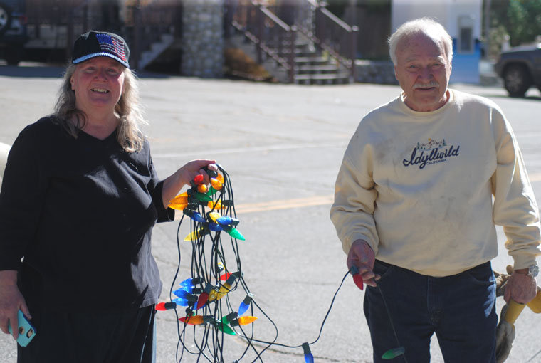 Phyllis Mueller and Joe McNabb began hanging the Christmas lights on the sequoia at Jo'An's Monday. Idyllwild's 56th-annual Christmas Tree Lighting Ceremony will be Saturday, Nov. 26, and is sponsored by Soroptimist International of Idyllwild. Photo by JP Crumrine