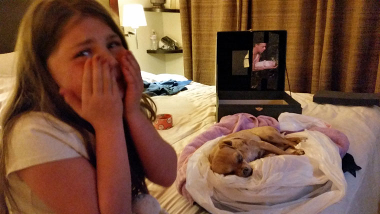 Rosa Garlock sits broken hearted with her dog Me-Me Garlock after a mountain lion had attacked it last week. Photo courtesy Tony Garlock