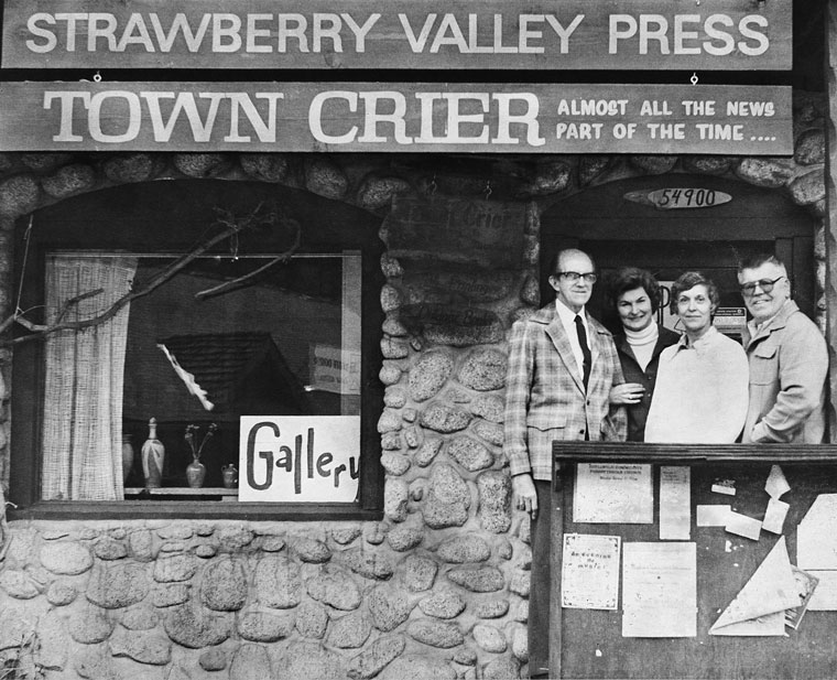 In May 1978, Luther and Marilyn Weare (left) pass the baton of the Idyllwild Town Crier to L.B. and Dorothy Hunsaker. Here, they pose on the steps of one of the little rock buildings that housed the newspaper up in Fern Valley. The Weares bought it from Ernie and Betty Maxwell in 1972. The Hunsakers owned it until 1989, a few months after Dorothy's death. File photo