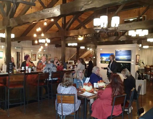 Soroptimist International of Idyllwild members invited potential members to an event last Wednesday at Middle Ridge Winery Tasting Gallery where the club shared details of their work and enjoyed food from Ferro. Here, President Theresa Teel talks about local programs. Photo by Halie Wilson